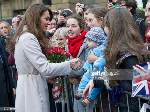 Catherine Duchess of Cambridge meets 5 monthold James William Davies who was named after Prince William and his mother Tessa Davies in the Market...