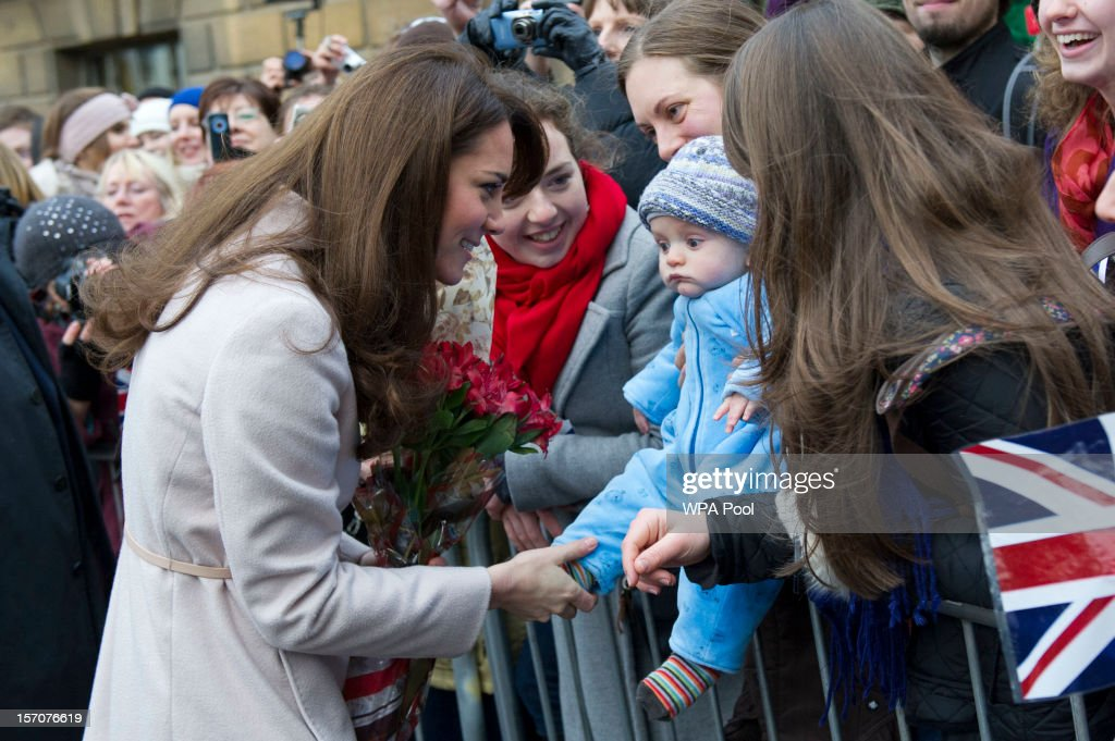 <a gi-track='captionPersonalityLinkClicked' href=/galleries/search?phrase=Catherine+-+Duchess+of+Cambridge&family=editorial&specificpeople=542588 ng-click='$event.stopPropagation()'>Catherine</a>, Duchess of Cambridge meets 5 month-old James William Davies, who was named after Prince William, and his mother Tessa Davies in the Market Square during an official visit to the Guildhall on November 28, 2012 in Cambridge, England.