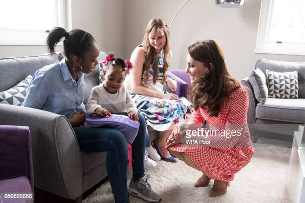 Catherine Duchess of Cambridge meets a mother Kirsty Francois and her daughter TeeganMia during a meeting with a parent support group at the launch...