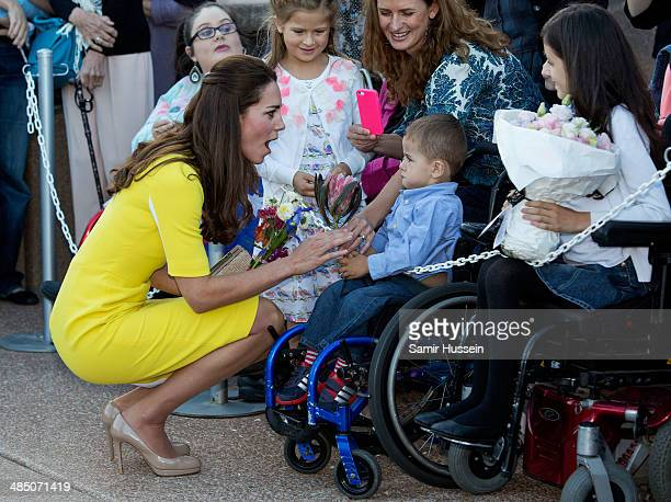 Catherine Duchess of Cambridge meets a well wisher in a wheel chair as she visits the Sydney Opera House on April 16 2014 in Sydney Australia The...