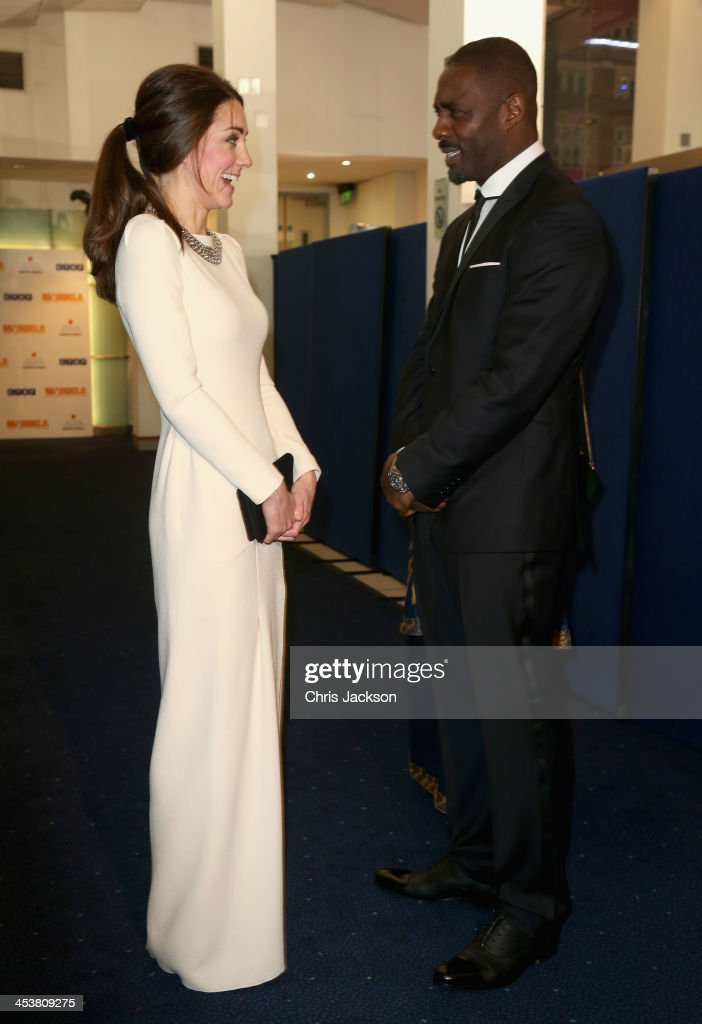 Catherine, Duchess of Cambridge meets actor Idris Elba as they attend the Royal film performance of 'Mandela: Long Walk to Freedom' at Odeon Leicester Square on December 5, 2013 in London, England.