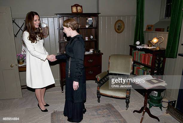 Catherine Duchess of Cambridge meets actress Phyllis Logan in her 'sitting room' during an official visit to the set of Downton Abbey at Ealing...