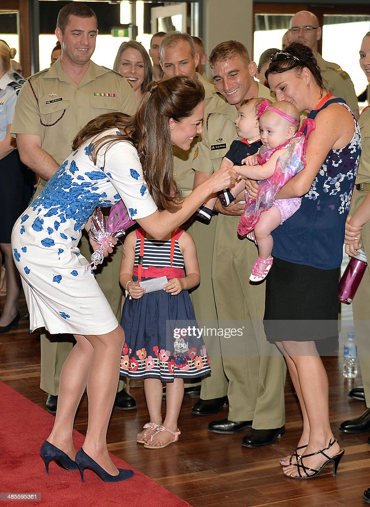 Catherine, Duchess of Cambridge meets baby twins Oscar and Alyssa McCabe as the Duke and Duchess of Cambridge visit RAAF base Amberley on April 19, 2014 in Brisbane, Australia. The Duke and Duchess of Cambridge are on a three-week tour of Australia and New Zealand, the first official trip overseas with their son, Prince George of Cambridge.