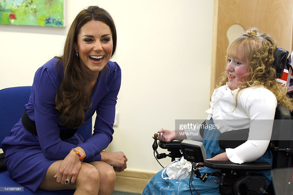Catherine, Duchess of Cambridge meets Bethany Woods in a music class during a visit to open The Treehouse Children's Hospice on March 19, 2012 in Ipswich, England.