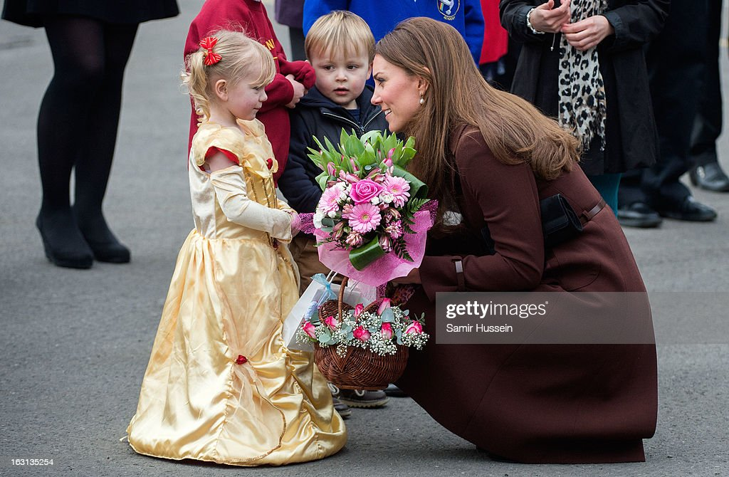 Catherine, Duchess of Cambridge meets children as she visits Humberside Fire and Rescue during an official visit to Grimsby on March 5, 2013 in Grimsby, England.