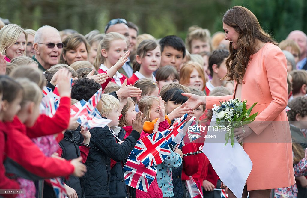 Catherine, Duchess of Cambridge meets children as she visits Naomi House on April 29, 2103 in Winchester, England.