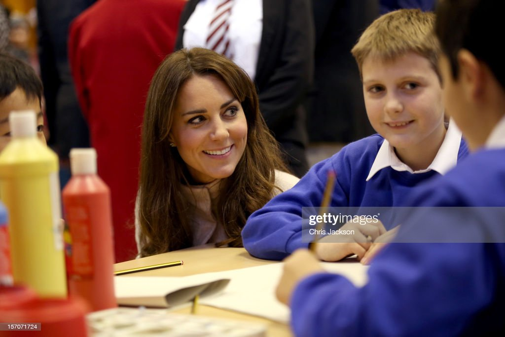 Catherine, Duchess of Cambridge meets children working on projects as she visits Manor School as she pays an official visit to Cambridge with Prince William, Duke of Cambridge on November 28, 2012 in Cambridge, Cambridgeshire.