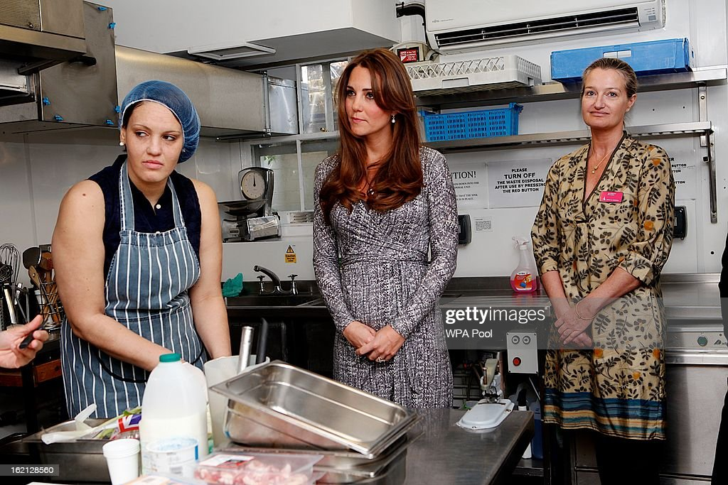 Catherine, Duchess of Cambridge meets counsellor Lou Kramer (R) and Hope House resident Sabrina (L) as she visits the kitchens at Hope House residential centre, run by Action on Addiction for recovering addicts on February 19, 2013 in London, England. The Duchess, who is patron of the centre spent over an hour talking to residents at the centre, on her first public engagement since early January.