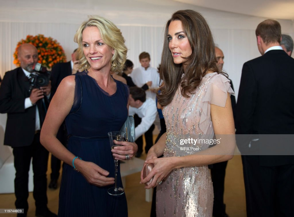 Catherine, Duchess of Cambridge meets Elizabeth Murdoch at the ARK 10th Anniversary Gala Dinner at Perk's Field on June 9, 2011 in London, England.