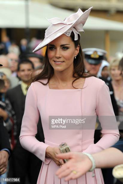 Catherine Duchess of Cambridge meets guests during a garden party at Buckingham Palace on May 29 2012 in London England