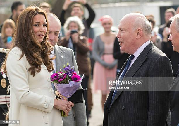 Catherine Duchess of Cambridge meets Julian Fellowes during an official visit to the set of Downton Abbey at Ealing Studios on March 12 2015 in...