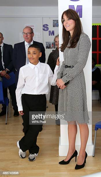 Catherine Duchess of Cambridge meets Kaionel who took her around his class and got her to play coordination games during a visit to the Anna Freud...