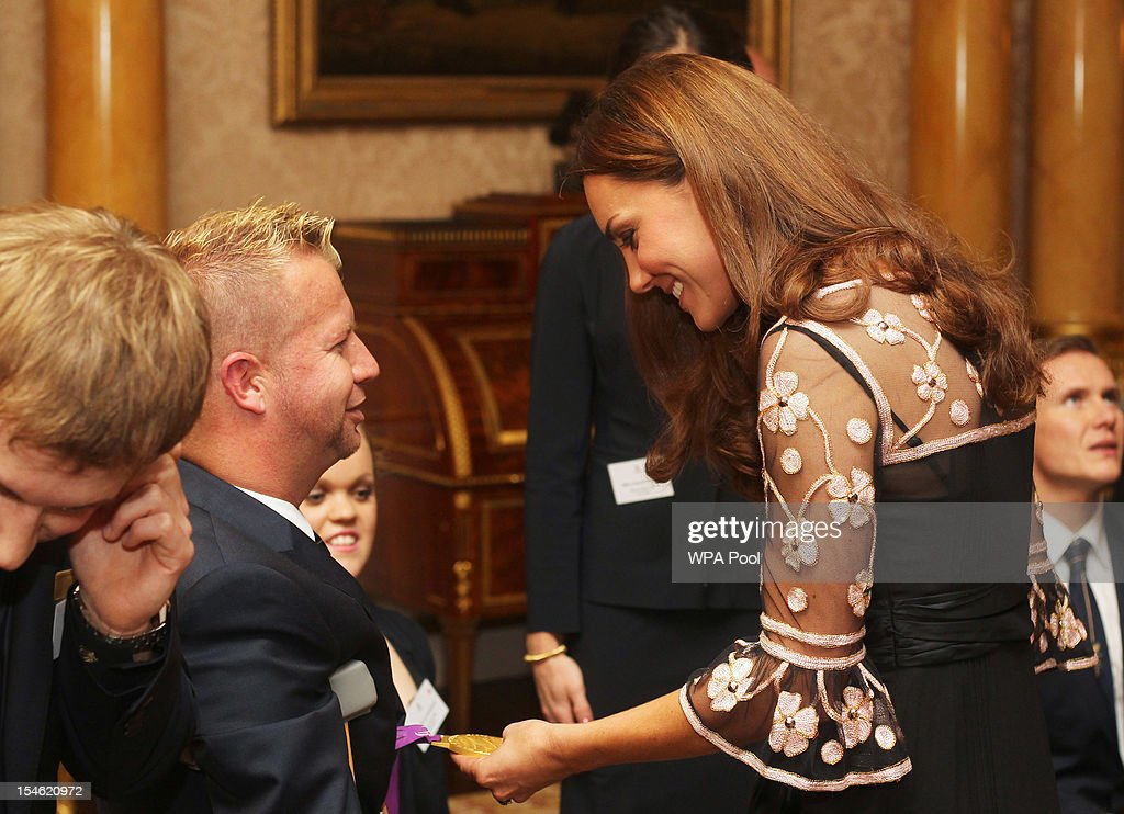 Catherine, Duchess of Cambridge meets Lee Pearson during a reception for the Team GB Olympic and Paralympic medalists at Buckingham Palace on October 23, 2012 in London, England.
