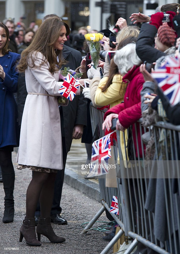 Catherine, Duchess of Cambridge meets members of the public in the Market Square during an official visit to the Guildhall on November 28, 2012 in Cambridge, England.