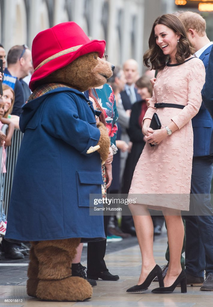 Catherine, Duchess of Cambridge meets Paddington Bear as she attends the Charities Forum Event on board the Belmond Britigh Pullman train at Paddington Station on October 16, 2017 in London, England.
