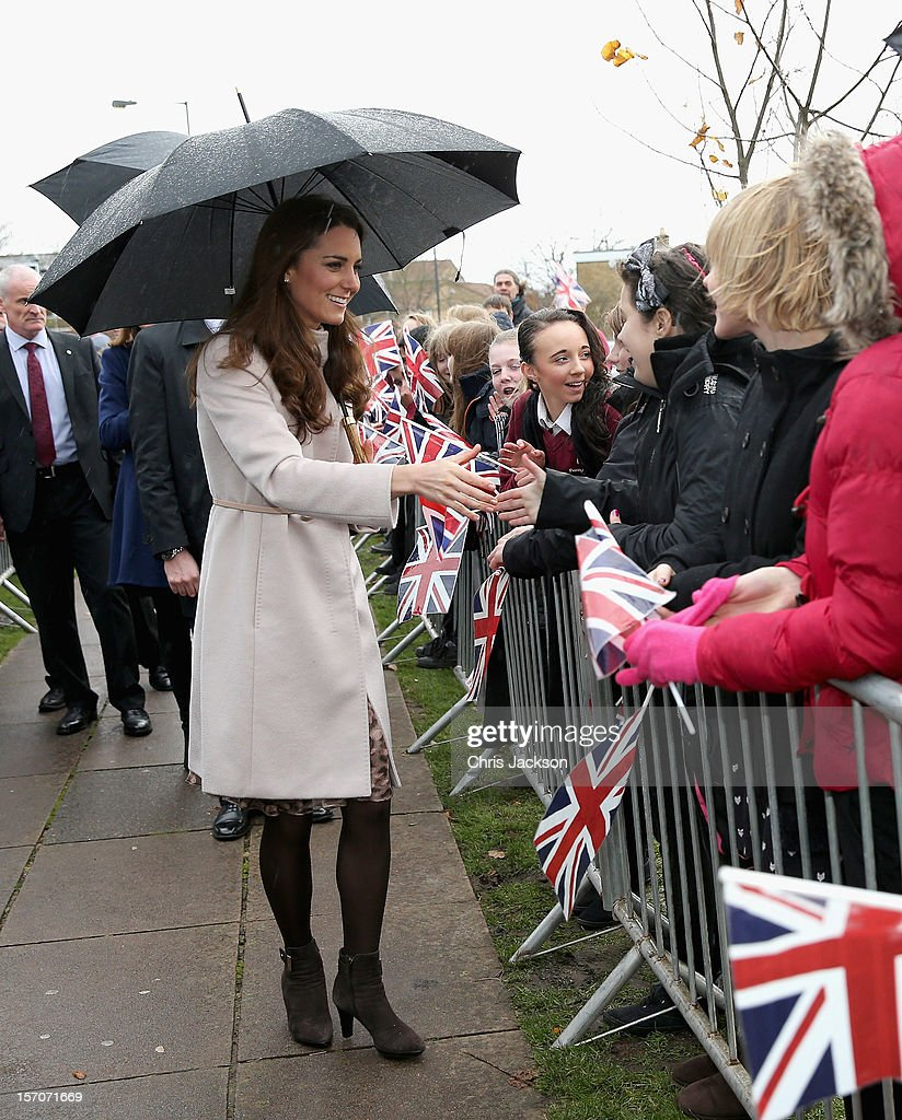 Catherine, Duchess of Cambridge meets pupils as she visits Manor School as she pays an official visit to Cambridge with Prince William, Duke of Cambridge on November 28, 2012 in Cambridge, United Kingdom.