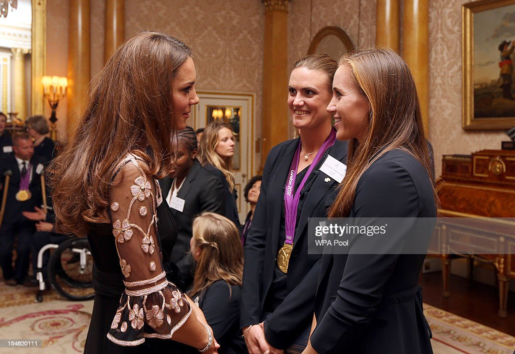 Catherine, Duchess of Cambridge meets rowers Heather Stanning (C) and Helen Glover during a reception for the Team GB Olympic and Paralympic medalists at Buckingham Palace on October 23, 2012 in London, England.