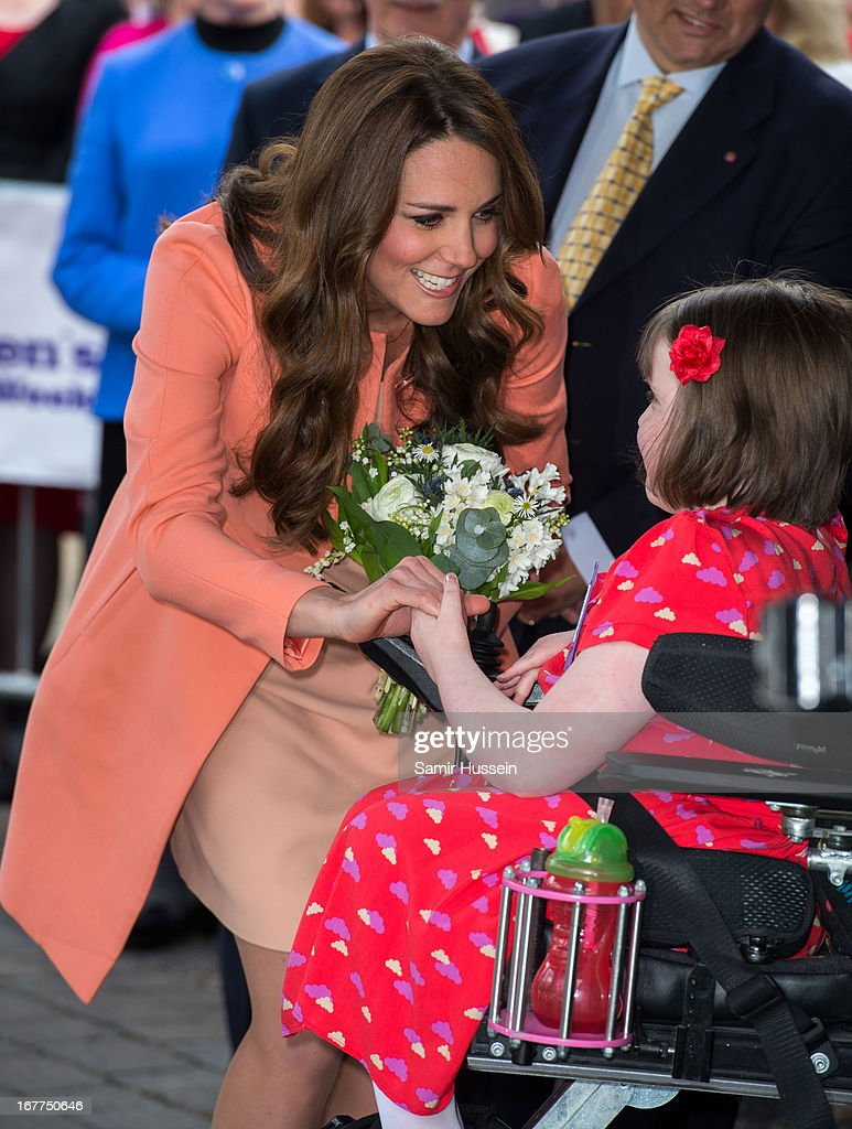Catherine, Duchess of Cambridge meets Sally Evans as she visits Naomi House on April 29, 2103 in Winchester, England.