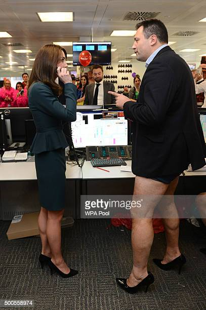 Catherine Duchess of Cambridge meets trader Nigel Hallagan as she and Prince William Duke of Cambridge attend the ICAP charity day at ICAP on...