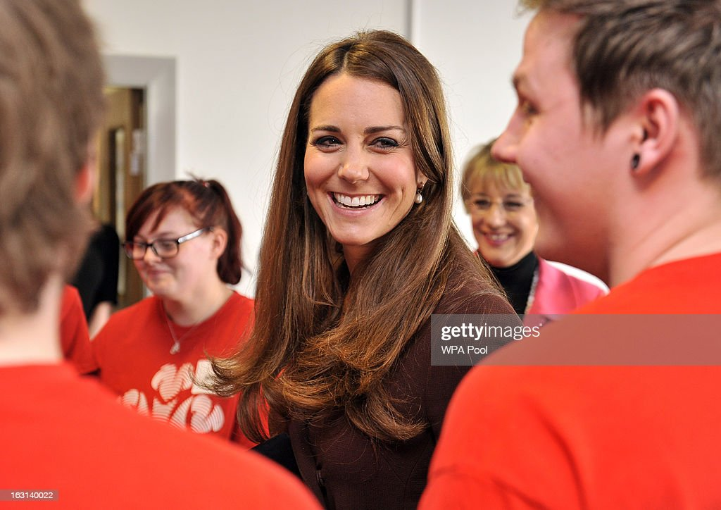 Catherine, Duchess of Cambridge meets unemployed young people taking part in The Princes Trust Scheme as she visits Humberside Fire and Rescue Peaks Lane Fire Station on March 5, 2013 in Grimsby, England.