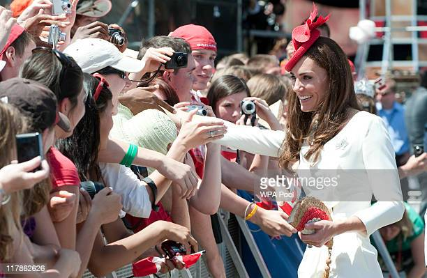 Catherine Duchess of Cambridge meets well wishers during the Canada Day Celebrations at Parliament Hill on day 2 of the Royal Couple's North American...