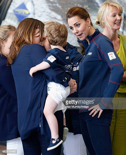 Catherine Duchess of Cambridge meets workers and families during a visit to the Ben Ainslie Racing team base as she attends the America's Cup World...