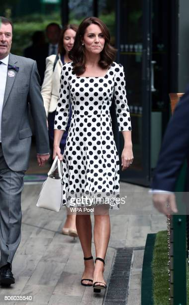 Catherine Duchess of Cambridge Patron of the All England Lawn Tennis and Croquet Club with Philip Brook on day one of the Wimbledon Championships at...