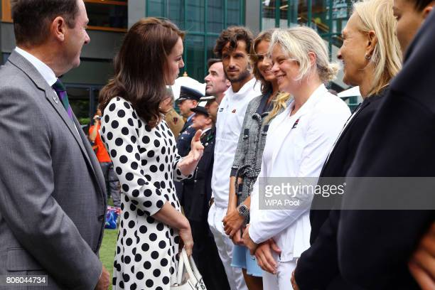 Catherine Duchess of Cambridge Patron of the All England Lawn Tennis and Croquet Club with Philip Brook speaks with Kim Clijsters on day one of the...