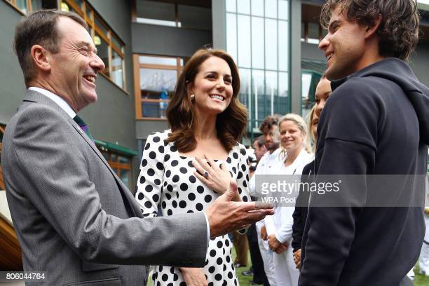 Catherine Duchess of Cambridge Patron of the All England Lawn Tennis and Croquet Club with Philip Brook chairman of the of the AELTC on day one of...