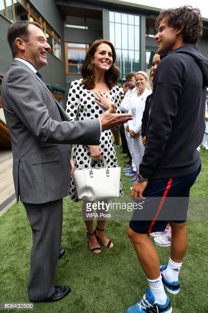 Catherine Duchess of Cambridge Patron of the All England Lawn Tennis and Croquet Club with AELTC Chairman Philip Brook as they meet Austrain tennis...
