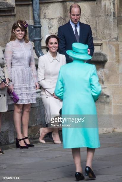Catherine Duchess of Cambridge performs a curtsy to Queen Elizabeth II as she attends Easter Day Service with Prince William Duke of Cambridge and...