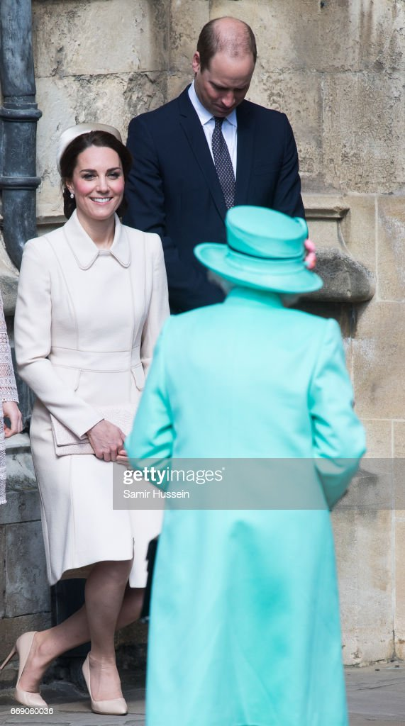 Catherine, Duchess of Cambridge performs a curtsy to Queen Elizabeth II as she attends Easter Day Service with Prince William, Duke of Cambridge at St George's Chapel on April 16, 2017 in Windsor, England.