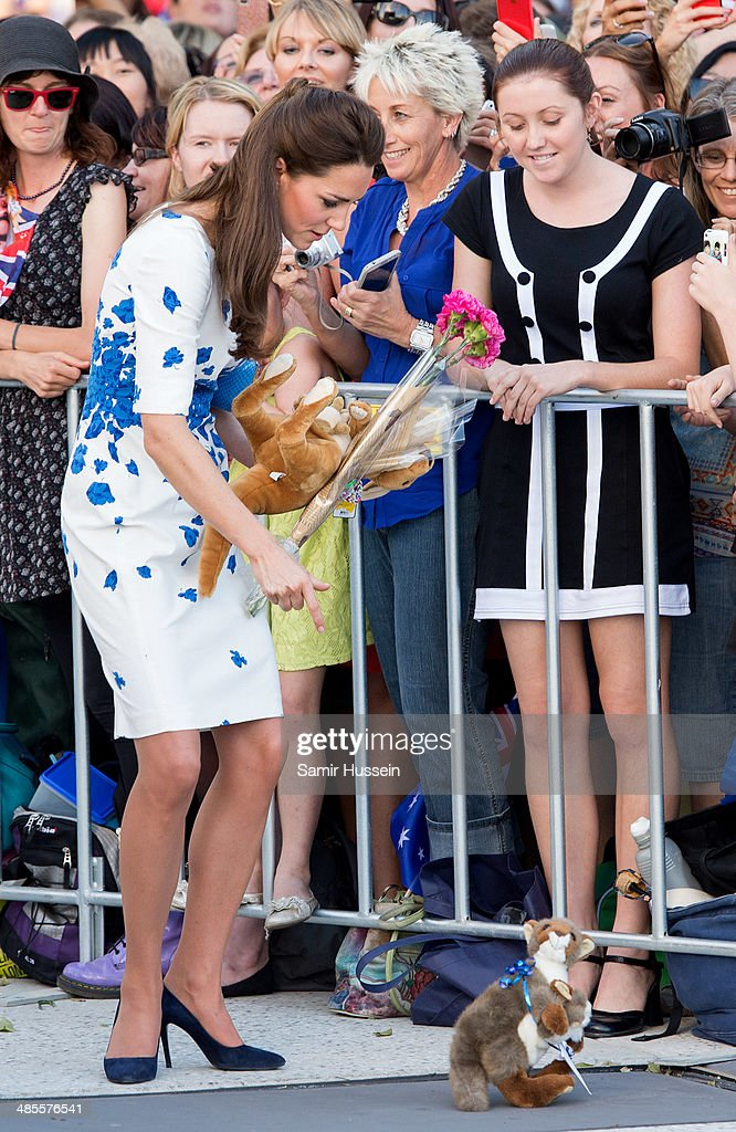 Catherine, Duchess of Cambridge picks up a toy kangaroo during a walkabout on April 19, 2014 in Brisbane, Australia. The Duke and Duchess of Cambridge are on a three-week tour of Australia and New Zealand, the first official trip overseas with their son, Prince George of Cambridge.
