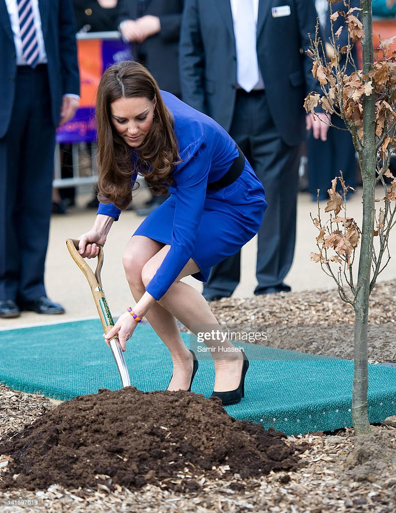 Catherine, Duchess of Cambridge plants a tree as she officially opens The Treehouse Children's Hospice on March 19, 2012 in Ipswich, England.