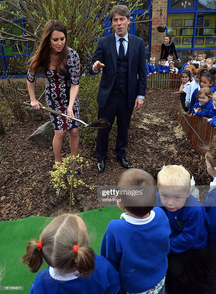 Catherine, Duchess of Cambridge (R), plants a willow tree with British comedian <a gi-track='captionPersonalityLinkClicked' href=/galleries/search?phrase=John+Bishop+-+Actor&family=editorial&specificpeople=7360807 ng-click='$event.stopPropagation()'>John Bishop</a> (L) as she listens to speeches during her visit to The Willows Primary School, Wythenshawe to launch a new school counseling program on April 23, 2013 in Manchester, England. The Duchess of Cambridge met staff and volunteers, teachers and parents at the school as she launched the program which is a partnership between the Royal Foundation, Comic Relief, Place2Be and Action on Addiction.
