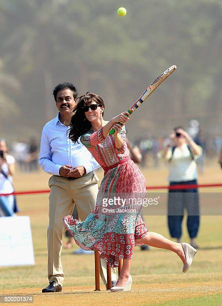 Catherine Duchess of Cambridge plays cricket during a visit to meet children from Magic Bus Childline and Doorstep three nongovernmental...