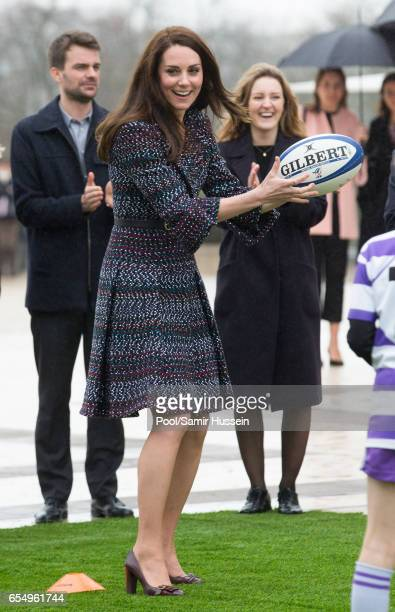 Catherine Duchess of Cambridge plays rugby with young French rugby fans at the Trocadero square near the Eiffel Tower on March 18 2017 in Paris...