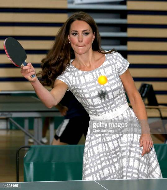Catherine Duchess of Cambridge plays table tennis as she visits Bacon's College on July 26 2012 in London England Prince Harry Prince William Duke of...