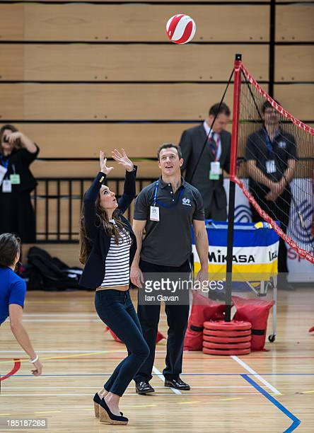 Catherine Duchess of Cambridge plays volleyball during her visit to a Sportaid Athlete Workshop at Queen Elizabeth Olympic Park on October 18 2013 in...