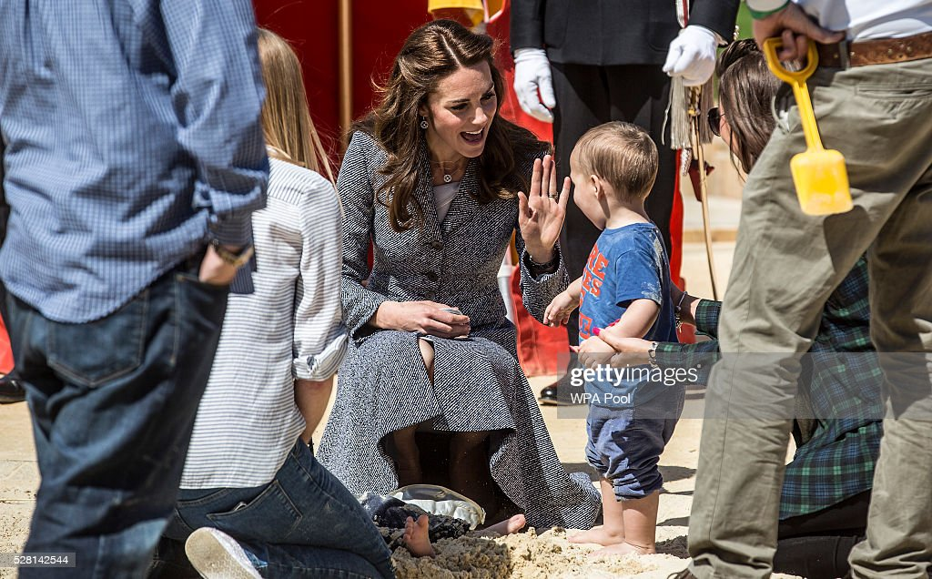 <a gi-track='captionPersonalityLinkClicked' href=/galleries/search?phrase=Catherine+-+Duchess+of+Cambridge&family=editorial&specificpeople=542588 ng-click='$event.stopPropagation()'>Catherine</a>, Duchess of Cambridge plays with a young child in a sand pit as she officially opens The Magic Garden at Hampton Court Palace on May 4, 2016 in London, England.