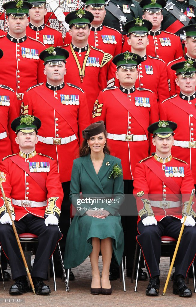 Catherine, Duchess of Cambridge poses for an official photograph she visits Aldershot Barracks on St Patrick's Day on March 17, 2012 in Aldershot, England. The Duchess presented shamrocks to the Irish Guards at a St Patrick's Day parade during her visit.