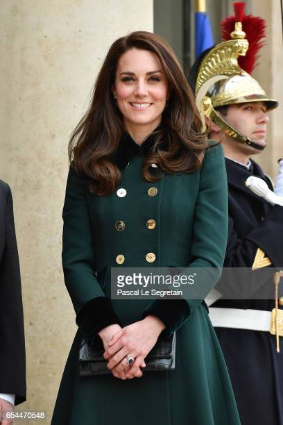 Catherine Duchess of Cambridge poses prior a meeting with French President Francois Hollande at the Elysee Palace during day one of their visit on...