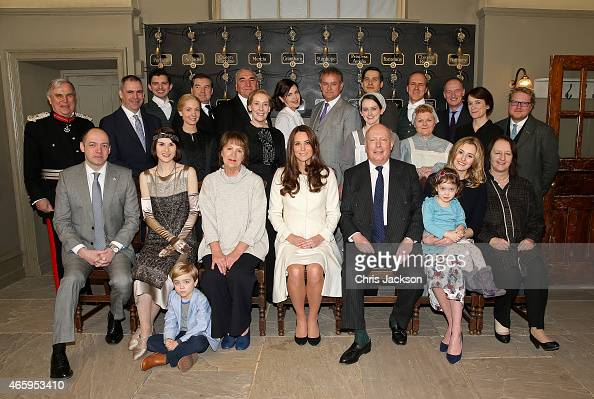 Catherine Duchess of Cambridge poses with cast crew and producers of Downton Abbey during an official visit to the set of Downton Abbey at Ealing...