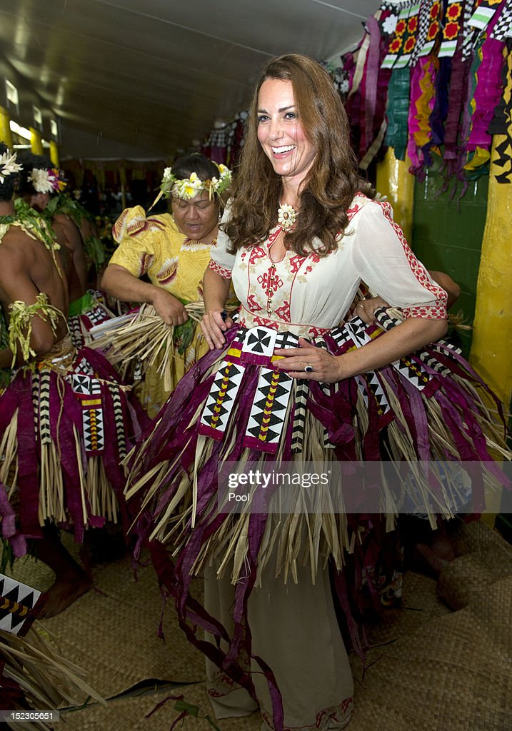 <a gi-track='captionPersonalityLinkClicked' href=/galleries/search?phrase=Catherine+-+Duchess+of+Cambridge&family=editorial&specificpeople=542588 ng-click='$event.stopPropagation()'>Catherine</a>, Duchess of Cambridge prepares to dance with the ladies at the Vaiku Falekaupule for an entertainment programme on September 18, 2012 in Tuvalu. Prince William, Duke of Cambridge and <a gi-track='captionPersonalityLinkClicked' href=/galleries/search?phrase=Catherine+-+Duchess+of+Cambridge&family=editorial&specificpeople=542588 ng-click='$event.stopPropagation()'>Catherine</a>, Duchess of Cambridge are on a Diamond Jubilee tour representing the Queen taking in Singapore, Malaysia, the Solomon Islands and Tuvalu.