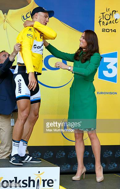 Catherine Duchess of Cambridge presents Marcel Kittel with the yellow jersey after he won stage one of the Tour de France on July 5 2014 in Harrogate...