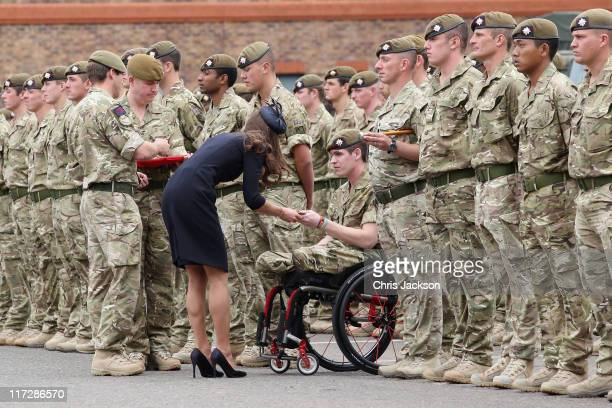 Catherine Duchess of Cambridge presents medals to members of the Irish Guards at the Victoria Barracks on June 25 2011 in Windsor England The Duchess...