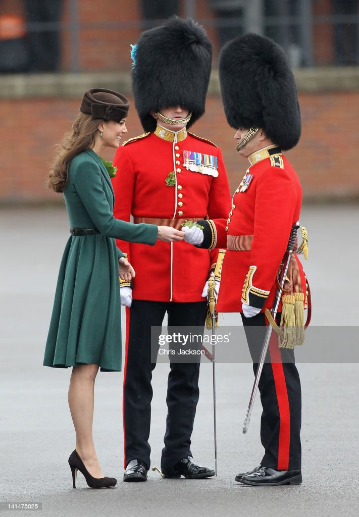 Catherine, Duchess of Cambridge presents 'shamrocks' as she takes part in a St Patrick's Day parade as she visits Aldershot Barracks on St Patrick's Day on March 17, 2012 in Aldershot, England. The Duchess presented shamrocks to the Irish Guards at a St Patrick's Day parade during her visit.