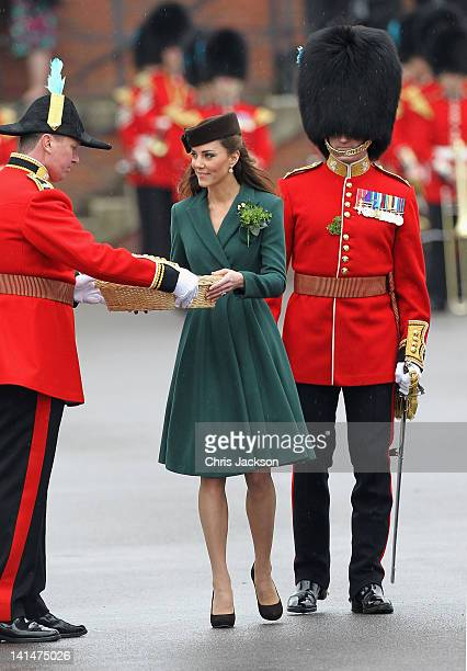 Catherine Duchess of Cambridge presents 'shamrocks' as she takes part in a St Patrick's Day parade as she visits Aldershot Barracks on St Patrick's...
