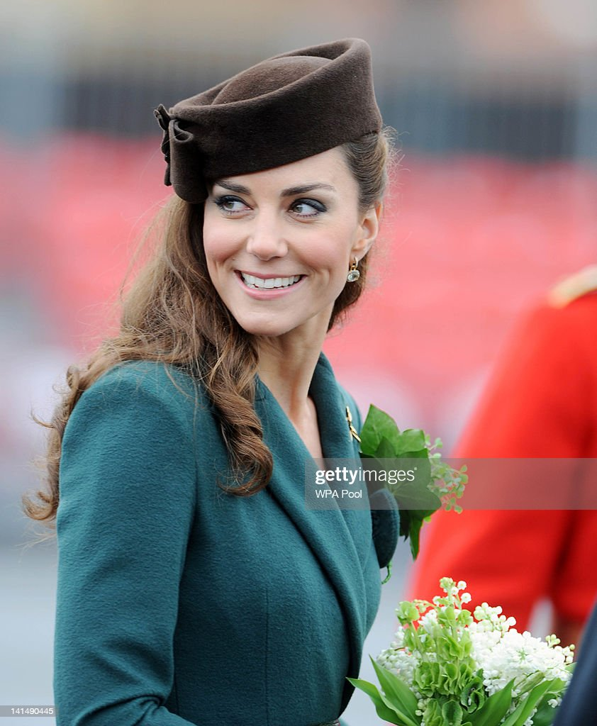 Catherine, Duchess of Cambridge presents shamrocks to members of the 1st Battalion Irish Guards at the St Patrick's Day Parade at Mons Barracks on Saturday March 17, 2012 in Aldershot, England. 450 soldiers were on parade, accompanied by the regimental mascot Conmeal, an Irish wolfhound who received his own sprig of shamrock from the Duchess. This was her first solo military engagement and she will now inherit a tradition which begun in 1901 by Queen Alexandra and more recently carried out for 32 years by the Queen Mother. Prince William is honorary Colonel of the Irish Guards.