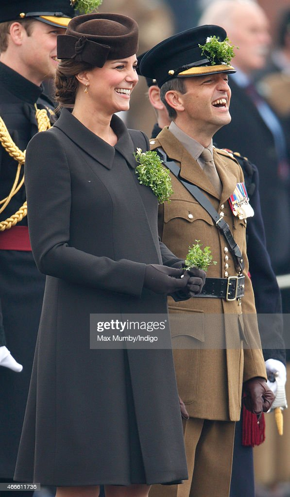 Catherine Duchess of Cambridge presents Shamrocks to soldiers of the Irish Guards as she attends the annual St Patrick's Day Parade at Mons Barracks...
